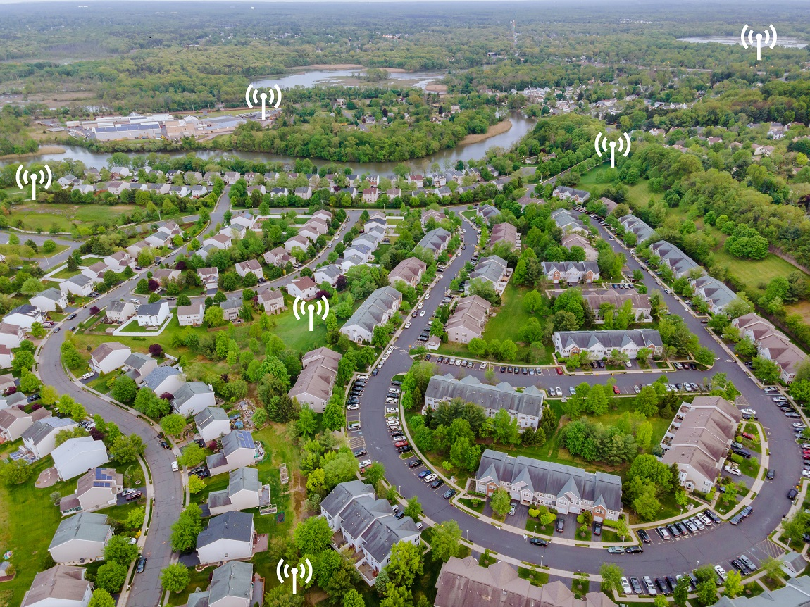 Aerial top view of small town urban landscape roofs of neighborhood with houses